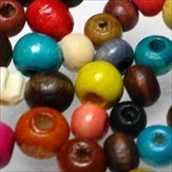 さまざまな色に着色されたウッドシードビーズです